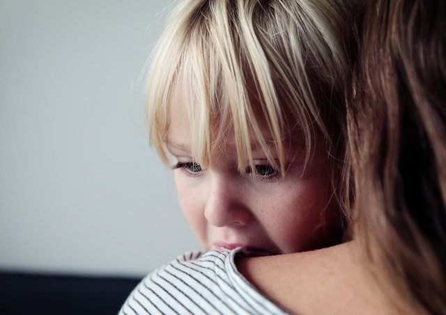 sad crying little girl hugging mother, parenting concept