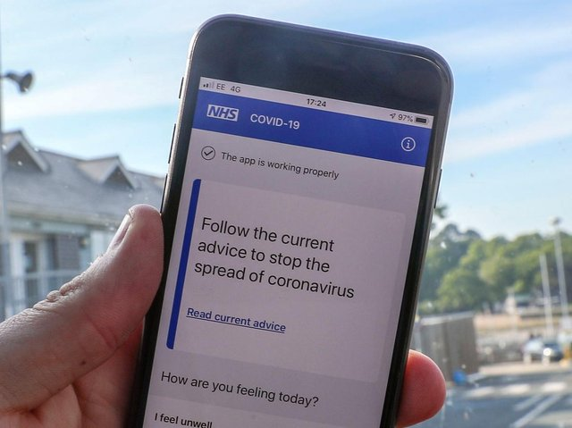 File photo of a person using the NHS coronavirus contact tracing app. The Department of Health and Social Care has said the Government will abandon its efforts to develop its own coronavirus contact-tracing app in order to focus on technology from Apple and Google. Photo: PA