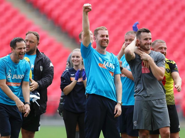 Harrogate Town's manager Simon Weaver celebrates after his team's victory in the Vanarama National League play off final at Wembley Stadium.