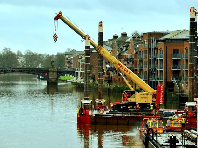 A crane manouvres onto a barge onto the River Ouse at Queens Staith in York in preparation for work on the Guildhall. Photo: Gary Longbottom
