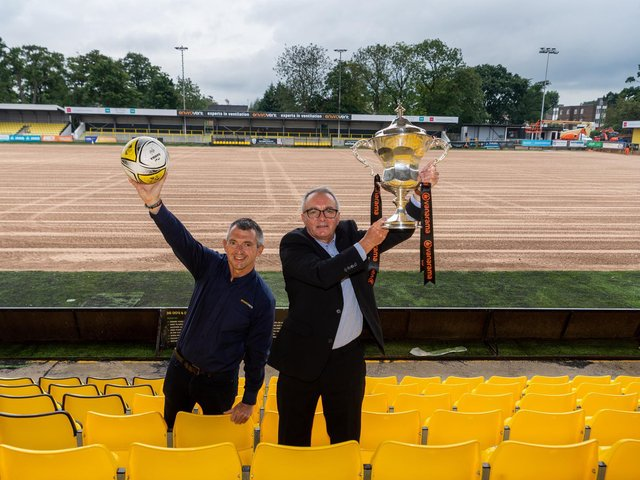 Exciting new deal- Andy Makin, sponsors EnviroVent's managing director celebrates the announcement at Wetherby Road with Garry Plant, managing director of Harrogate Town - and the league trophy!
