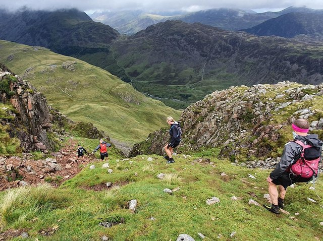 Harrogate Harriers fell runner Helen Price descending a gulley in the Lake District during the Joss Naylor Challenge. (Picture by Simon Franklin)