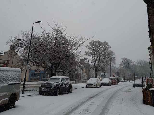 The wintry scene this morning on Skipton Road in Harrogate this morning as heavy snow showers returned to disrupt traffic.