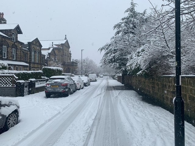Yellow weather warning - Road and pavement blend into one today at Grove Road in Harrogate.