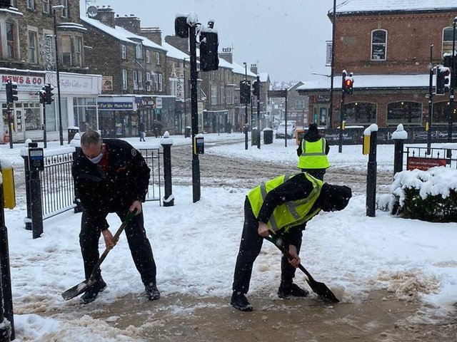 Clearing snow at Harrogate Bus Station.