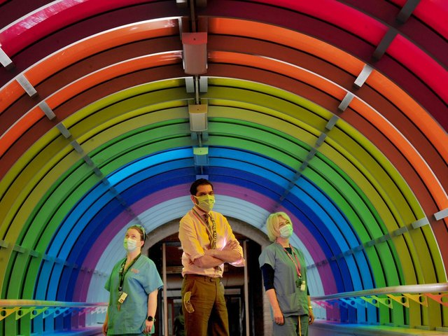 From left: Paula De Souza resusitation Lead, Steve Russell Chief Exec of Harrogate District Hospital and Sally Blackburn Mental Health Liason in the rainbow tunnel to celebrate diversity at the hospital.