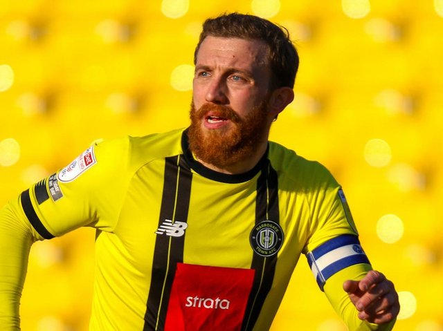 George Thomson was handed the captain's armband for Harrogate Town's League Two showdown with Grimsby. Pictures: Matt Kirkham
