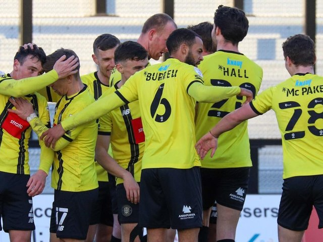 Harrogate Town players celebrate after Mark Beck handed them a 77th-minute lead against Grimsby Town. Pictures: Matt Kirkham