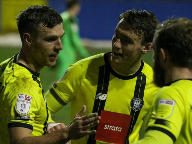 Jack Muldoon, left, is congratulated on his late winner at Barrow. Pictures: Matt Kirkham