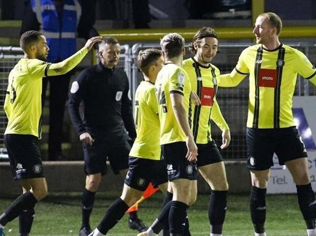 Mark Beck, right, celebrates with his Harrogate Town team-mates after netting a first-minute strike against Colchester United. Picture: Matt Kirkham