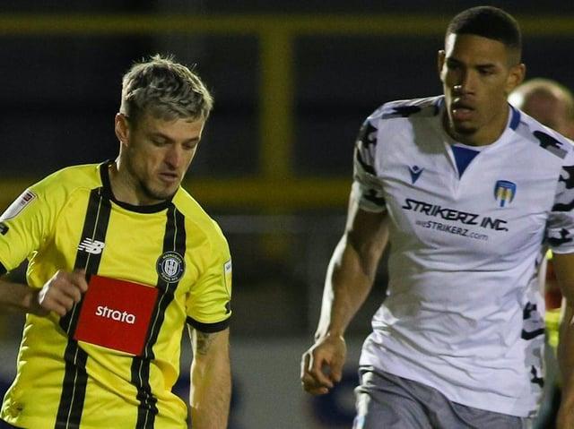 Harrogate Town striker Josh March in action against Colchester United. Pictures: Matt Kirkham