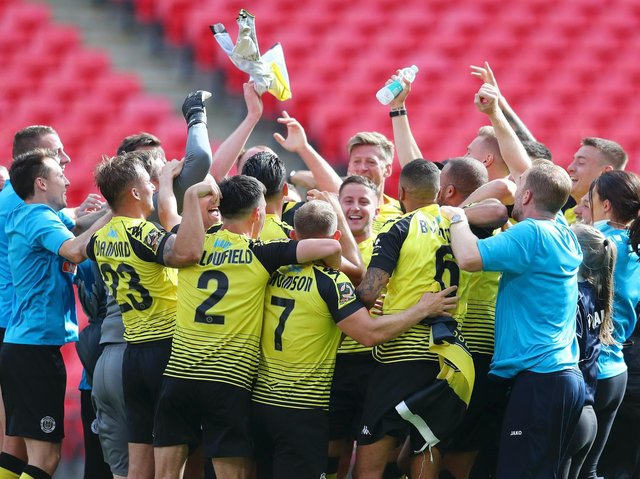 Harrogate Town players and staff celebrate on the Wembley turf following their 2019/20 National League play-off final success over Notts County. Picture: Getty Images