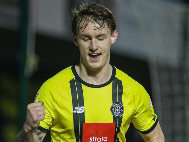Will Smith celebrates after putting Harrogate Town 2-0 up against Colchester United. Pictures: Matt Kirkham