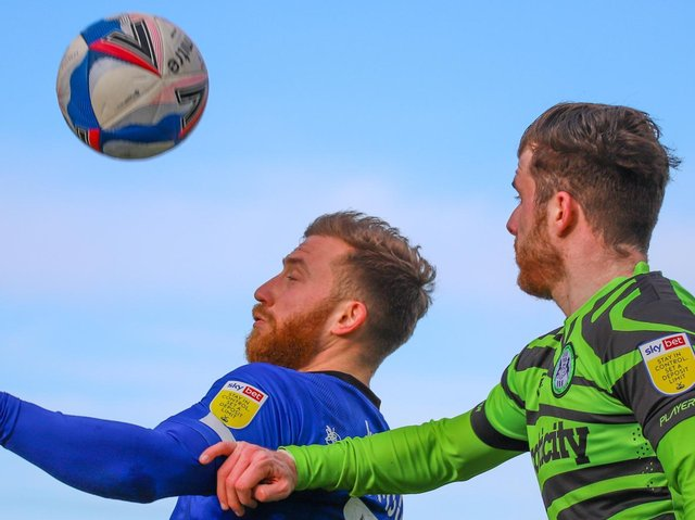 George Thomson challenges for a header during Harrogate Town's defeat at Forest Green Rovers. Pictures: Matt Kirkham