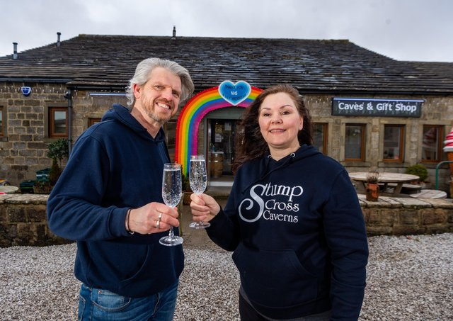 Lisa Bowerman, owner of Stumps Cross Caverns, with her partner Nick Markham, celebrating the news of reaching the fundraising target to keep the Pateley Bridge attraction open. Picture James Hardisty.