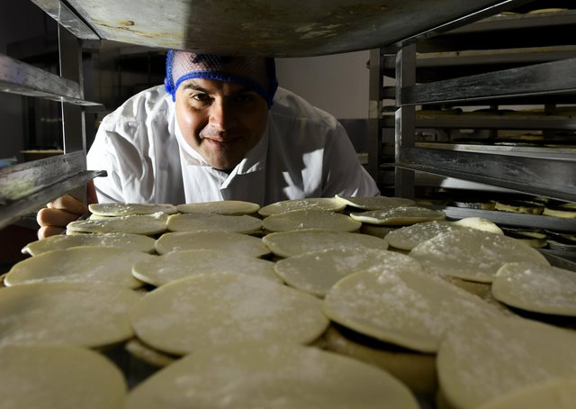 James Sturdy  the owner of Sturdy  Foods near  Ripon looking at some pof their Yorkshire Homemade  Pies.