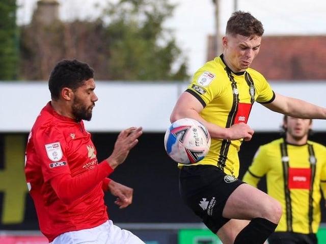 Harrogate Town's Josh McPake beats Morecambe defender Kelvin Mellor to the ball during Saturday's League Two clash at the EnviroVent Stadium. Picture: Matt Kirkham