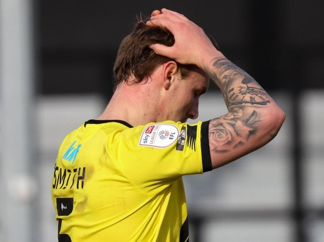 Harrogate Town centre-half Will Smith holds his head in his hands during Saturday's 1-0 home defeat to Morecambe. Pictures: Matt Kirkham