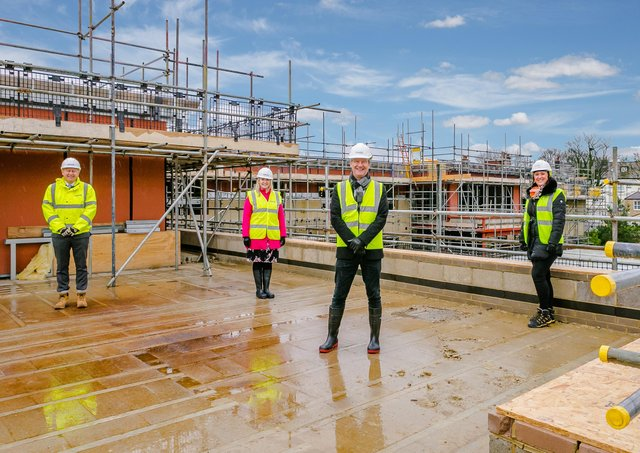 Celebrating the topping out of Springfield's luxury new care home in Harrogate are (l to r) Neil Silcock (Simpson), Sally Rasmussen (Springfield Healthcare), Graeme Lee (Springfield Healthcare) and Jo Hawkins-Spencer (Projex Building.