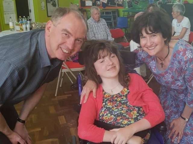 Henshaws' champion fundraising student Flora Nelson with her parents, David and Sally.