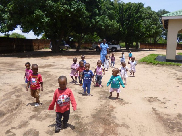 Children in Africa being supported by Harrogate-based charity Open Arms Malawi.