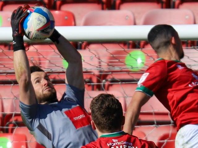 Harrogate Town goalkeeper James Belshaw in action against Walsall at the Banks's Stadium. Pictures: Matt Kirkham