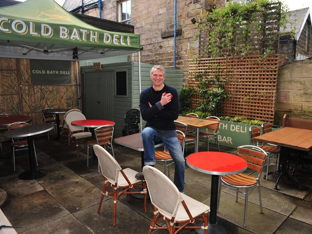 Welcome! Pictured ready to open on 12th April is cafe/deli owner Peter Woolrich who is pictured in his outside dinning area at the Cold Bath Deli, Harrogate. (Picture Gerard Binks)