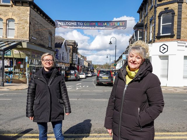 Flying the flag for Commercial Street shops with a giant new banner - Harrogate BID chair Sara Ferguson and Sue Kramer with Commercial Street Retailers group.