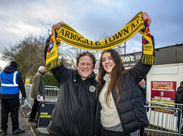 Showing their support with a Harrogate Town scarf - Fans Dave Worton and daughter Molly before a match earlier in the season.