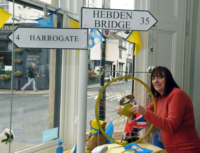 290416     Carole Ratcliffe Receptionist at  Samanatha Parker Opticians  in Knaresborough getting the window display ready as the town gears up for the arrival of stage one of the Tour De Yorkshire (GL1009/86f)