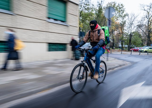 """Carers and bike couriers are among the roles that Green New Deal UK says should be regarded as """"green"""". Pic: WOJTEK RADWANSKI/AFP via Getty Images"""