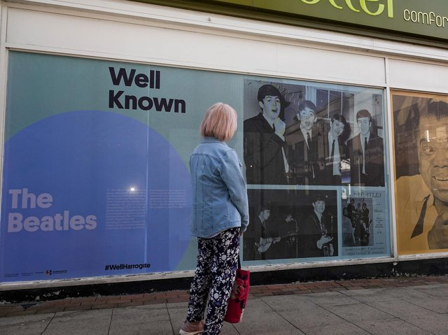 A shopper stops to read the story of the Beatles' visit to Harrogate on Friday, 8 March, 1963.