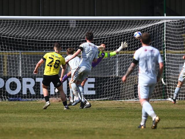 Josh McPake curls home Harrogate Town's late winner against Bradford City. Pictures: Jonathan Gawthorpe