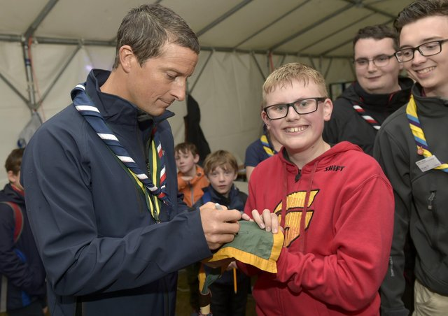 Chief Scout Bear Grylls with  scouts at Bramhope as part of their Youth Commissioners Challenge badge  Bear Grylls signs for Thomas Bliss, 13