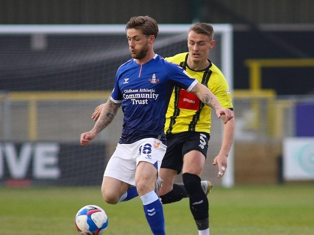 Harrogate Town defender Will Smith closes down Oldham Athletic's Conor McAleney at the EnviroVent Stadium. Picture: Matt Kirkham