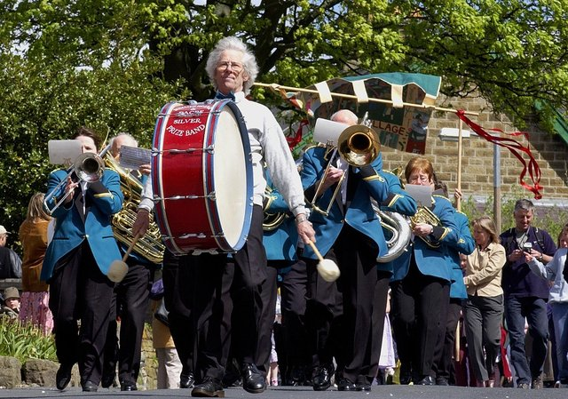 The Dacre Silver Band leads the procession at Glasshouses May Day Gala in 2004.