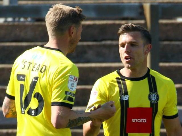 Harrogate Town's Jack Muldoon celebrates his goal against Carlisle United with strike partner Jon Stead. Pictures: Matt Kirkham