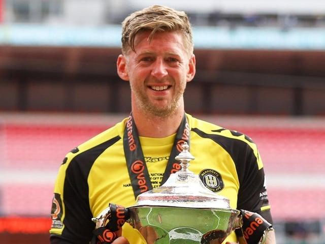 Harrogate Town striker Jon Stead at Wembley Stadium with the 2019/20 National League play-off final winners' trophy. Pictures: Matt Kirkham
