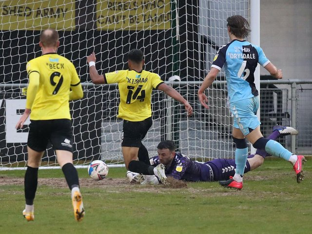 Harrogate Town forward Brendan Kiernan scores from close range to complete his hat-trick in Friday night's 5-4 success over Cambridge United. Pictures: Getty Images