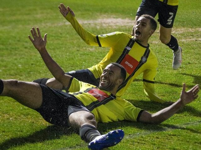 Harrogate Town centre-half Kevin Lokko celebrates his 84th-minute winner against Cambridge United. Pictures: Matt Kirkham