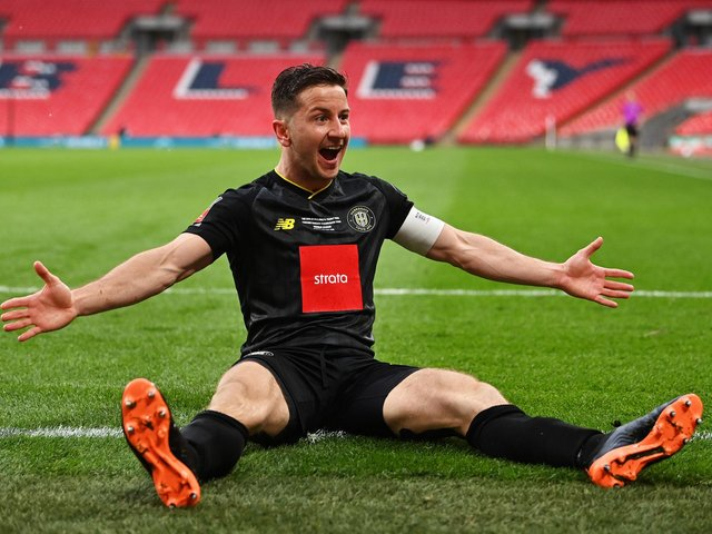 Harrogate Town captain Josh Falkingham celebrates after netting the winner against Concord Rangers at Wembley in the FA Trophy this afternoon. Picture: Getty Images.