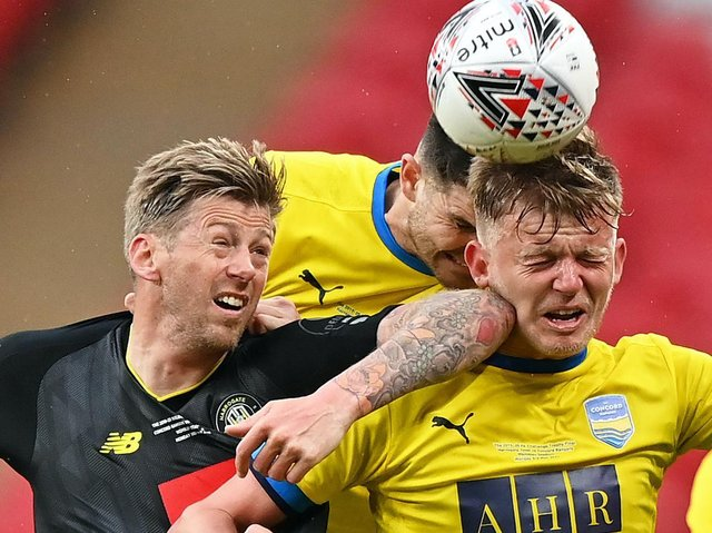 Harrogate Town striker Jon Stead competes for the ball with two Concord Rangers defenders. Pictures: Getty Images