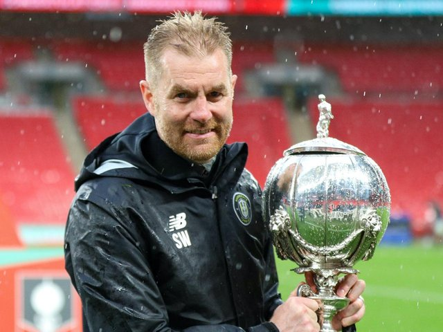 Harrogate Town manager Simon Weaver with the FA Trophy following his side's 1-0 win over Concord Rangers at Wembley Stadium. Picture: Matt Kirkham