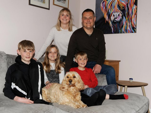 Reunited: The wandering Seth the Cockapoo back with his owners dad Nick Wield, mum Anna and children James, 14; Daisy, 11; and William, nine. (Picture Gerard Binks)