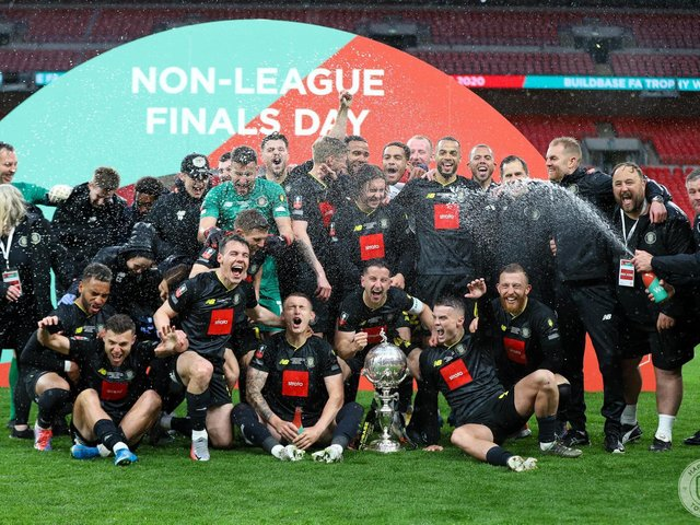 Wembley heroes: The victorious Harrogate Town team with the FA Trophy on Monday.