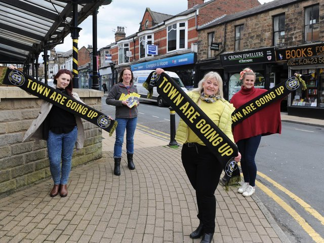 Harrogate Town is good for business - Flying the flag for town's football heroes are members of Commercial Street Retailers Group Eve Melia of AC Gallery, Jenny Smart of Books for All, Sue Kramer of Crown Jewellers and Alex Clarke of Foxy Antiques and Interiors.
