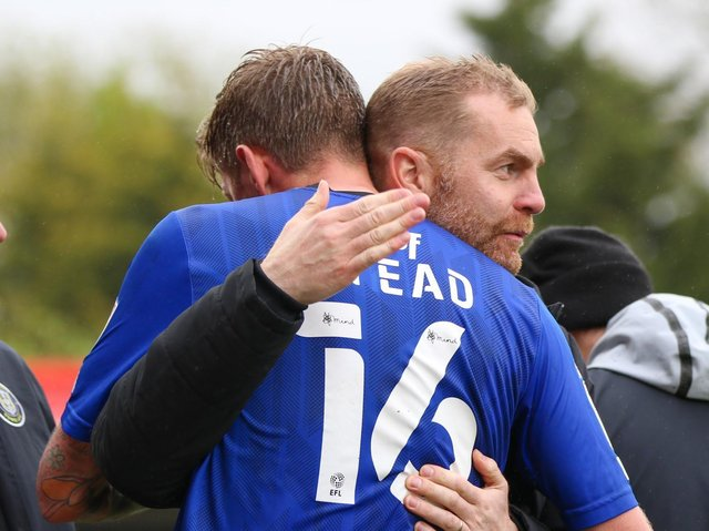 Jon Stead and Harrogate Town manager Simon Weaver embrace after the veteran striker was substituted at Cheltenham on what was the final appearance of his 19-year playing career. Picture: Matt Kirkham