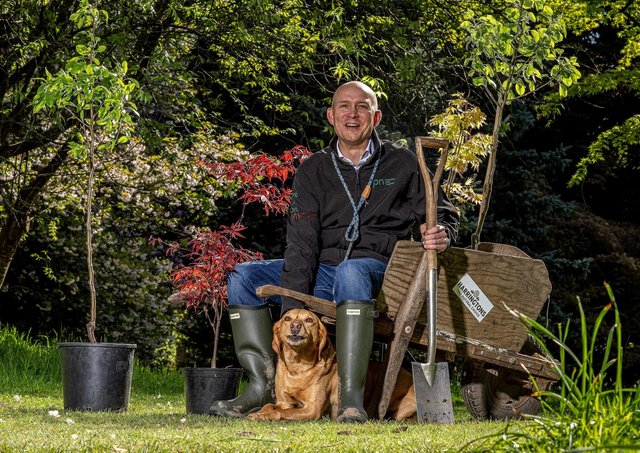 Dalton-based Inspired Pet Nutrition (IPN) has committed to planting one million trees across the UK. Pictured: CEO James Lawson and his dog Barney planting trees at Thorp Perrow Arboretum. PHOTO: Charlotte Graham.