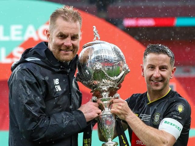Harrogate Town manager Simon Weaver and captain Josh Falkingham with the FA Trophy at Wembley Stadium. Picture: Matt Kirkham