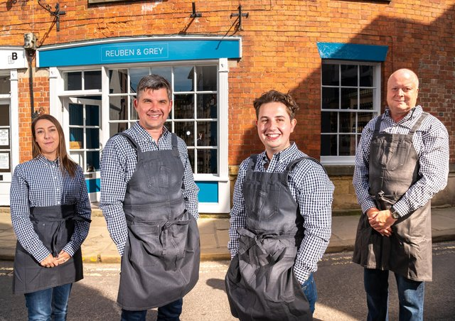 Cathy Meddows-Taylor, co-founders Craig Buchan and Luke Morland, and Mark Johnson outside Reuben & Grey, the fine wine shop they have opened in Knaresborough. PHOTO: Simon Dewhurst.